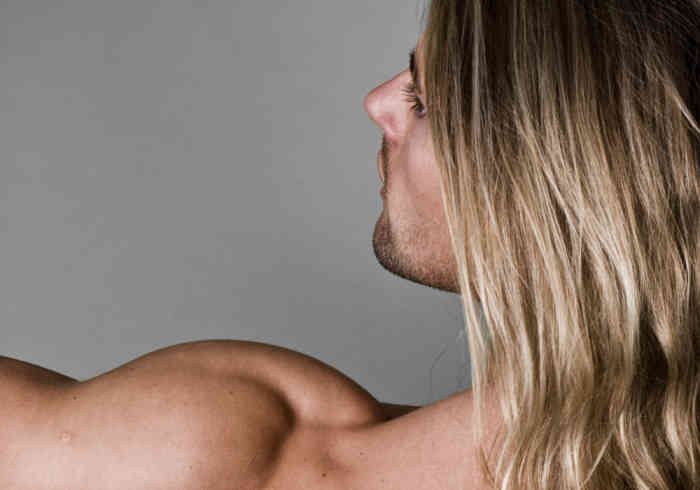 Male body builder back with long hair   Does MK-677 Cause Hair Loss?