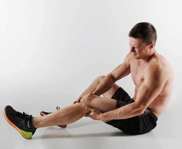 Does MK-677 Cause Joint Pain?  body builder with knee joint pain