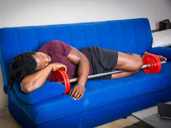 young strong black male sleeping on couch:does mk-677 improve sleep quality