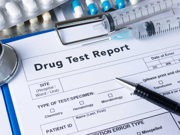 drug test report medical stethoscope with clipboard and black pen