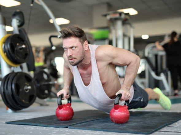 athletic man with fit muscles doing push